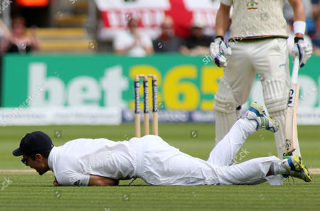 (Correction) England Captain Alastair Cook catches out Brad Haddin of Australia off the bowling of Moeen Ali.