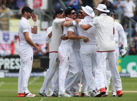 (Correction) England Captain Alastair Cook celebrates catching out Brad Haddin of Australia off the bowling of Moeen Ali.