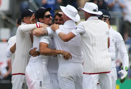 England Captain Alastair Cook celebrates catching out Brad Haddin of Australia off the bowling of Moeen Ali.