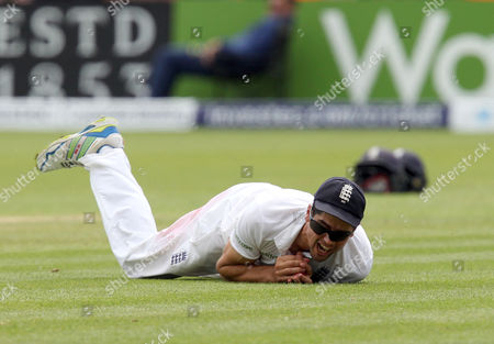 England captain Alastair Cook clings on to the ball after catching Brad Haddin of Australia at the 2nd attempt off the bowling of Moeen Ali.