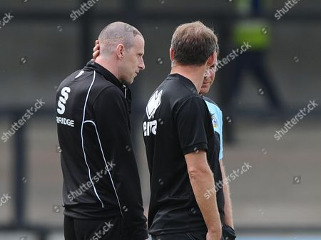 Stock Picture of Salisbury manager, Steve Claridge  who appears to have had a hair transplant talks with Bristol Rovers assistant manager, Marcus Stewart and Bristol Rovers Manager, Darrell Clarke
