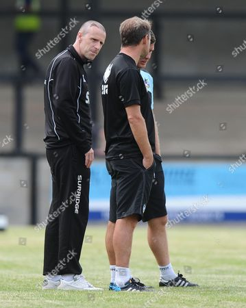 Stock Photo of Salisbury manager, Steve Claridge  who appears to have had a hair transplant talks with Bristol Rovers assistant manager, Marcus Stewart and Bristol Rovers Manager, Darrell Clarke