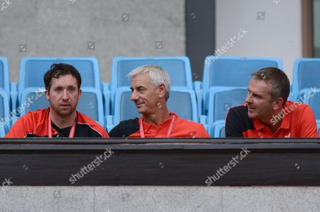 (L-R) Former Liverpool players Robbie Folwer, Ian Rush and Dietmar Hamann look on as Liverpool players warm up during a training session at Rajamangala stadium in Bangkok