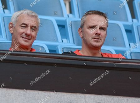 (L-R) Former Liverpool players Ian Rush and Dietmar Hamann look on as Liverpool players warm up during a training session at Rajamangala stadium in Bangkok