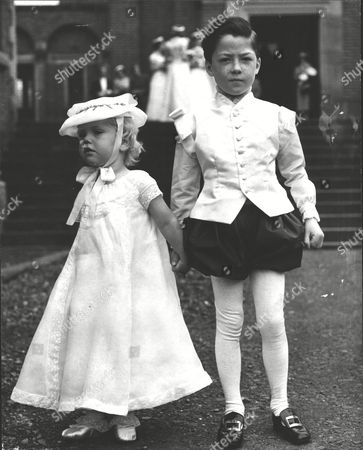 Stock Picture of Page Jamie Bruce And Kinvara Cayzer Attendants At The Wedding Of Miss Teresa Crossley. Box 0598 25062015 00334a.jpg.