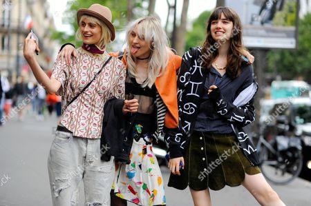 Models Veronika Vilim Lida Fox and Grace Harrtzel having fun with selfies, after Elie Saab Haute Couture, Rue Cambon, Paris