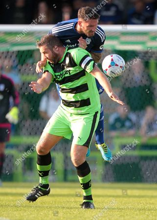 Sean Morrison of Cardiff City gets above Jon Parkin of Forest Green Rovers.