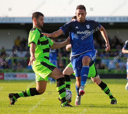 Federico Macheda of Cardiff City is tackled by Sam Wedgbury of Forest Green Rovers.