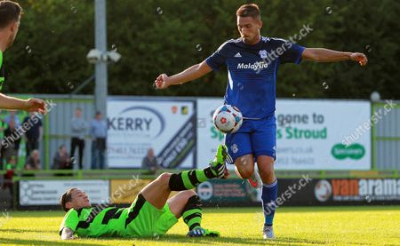 Federico Macheda of Cardiff City is tackled by James Jennings of Forest Green Rovers in the box.