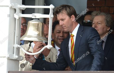 Brett Lee rings the five minute bell ahead of the start of play at the Second Ashes Test at Lord's Cricket Ground