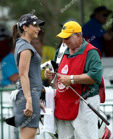 Paige Mackenzie talks to caddie after her 18th hole during the first round
