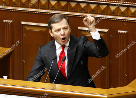 Stock Picture of The leader of the Radical Party Oleg Lyashko speaks to lawmakers before voting for constitutional changes on decentralizing power during parliament session in Kiev