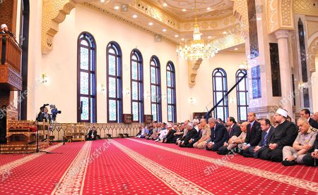 Abdel Fattah al-Sisi prays on the first full day of the Muslim holiday of Eid al-Fitr, which marks the end of the holy fasting month of Ramadan, at the Mohamed Hussein Tantawi Mosque, Cairo