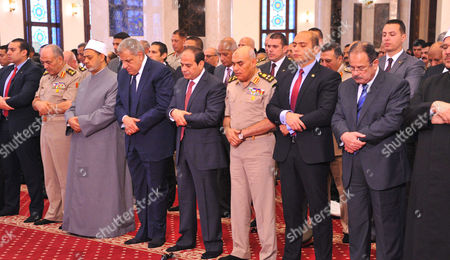 Stock Picture of Abdel Fattah al-Sisi prays on the first full day of the Muslim holiday of Eid al-Fitr, which marks the end of the holy fasting month of Ramadan, at the Mohamed Hussein Tantawi Mosque, Cairo
