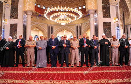 Stock Image of Abdel Fattah al-Sisi prays on the first full day of the Muslim holiday of Eid al-Fitr, which marks the end of the holy fasting month of Ramadan, at the Mohamed Hussein Tantawi Mosque, Cairo