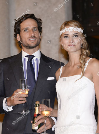 Feliciano Lopez and Alba Carrillo share a toast outside the Cigarral Restaurant