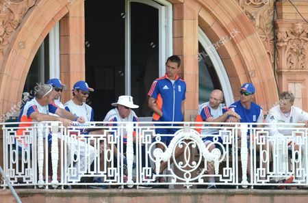 England batting coach Mark Ramprakash, 3rd left, is all smiles on the balcony despite both openers Alastair Cook, 2nd left, and Adam Lyth, 3rd right, both being out cheapy in the second innings  during the Second Ashes Test at Lord's Cricket Ground