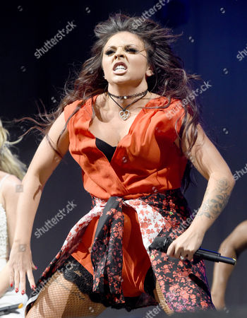 Jesy Nelson performs with Little Mix wearing her engagement ring after boyfriend Jake Roche proposed to her earlier in the evening