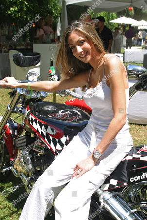 Katrina Campins on the Trim Spa motorcycle