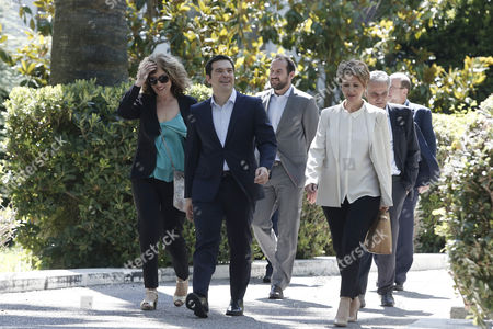 Prime Minister Alexis Tsipras with new deputy Foreign minister Sia Anagnostopoulou (L) and new government spokeswoman Olga Gerovasili exit the Presidential Palace after the swearing in ceremony of the new members of the Greek government.