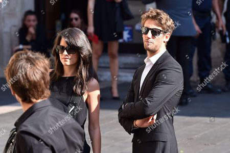 French driver Romain Grosjean and his wife Marion Jolles attend the funeral ceremony of French Formula One driver Jules Bianchi at the Cathedrale Sainte Reparate