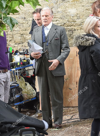 David Robb on the Downton Abbey set for final day of filming in Bampton, Oxfordshire carrying presents from te cast and crew.