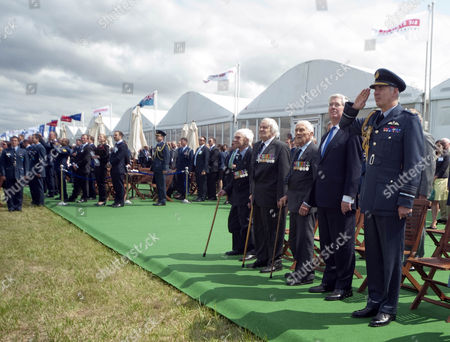 Air Chief Marshal Sir Andrew Pulford takes the Battle of Britain salute with veterans Flying Officer Ken Wilkinson, Squadron Leader Geoffrey Wellum, Squadron Leader Tony Pickering and Defence Secretary Michael Fallon