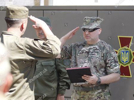 Secretary of National Security of Ukraine Oleksandr Turchynov (R) during a training session of National Guard on the shooting range in the village of Novi Petrivtsi, near Kiev