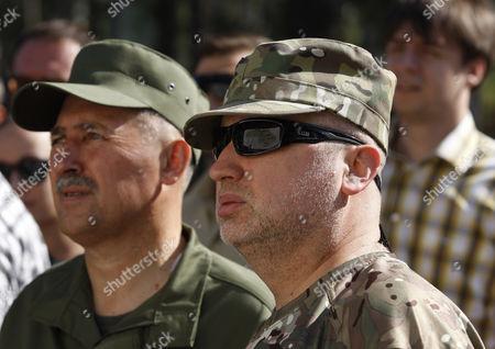 Secretary of National Security of Ukraine Oleksandr Turchynov (C) during a training session of National Guard on the shooting range in the village of Novi Petrivtsi, near Kiev