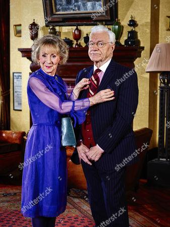 Stock Photo of Penelope [Marcia Warren] and Mason [Philip Voss]