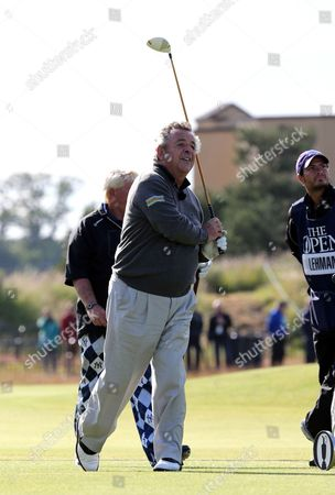 Tony Jacklin of England watches his shot during a practice round