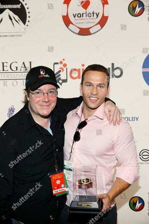Host Jamie Gold and Winner of the High Stakes tournament Grant Haas
