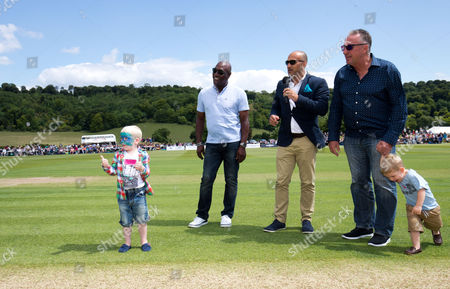 Sir Ian Botham, Viv Richards and Mark Butcher (c) get some young help with the toss (L)