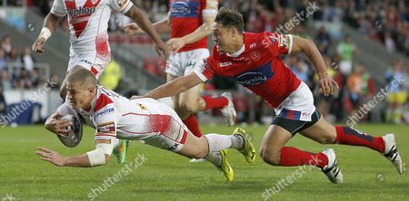 STS TRAVIS BURNS GOES OVER FOR THE 2ND TRY DESPITE EFFORTS BY DANE CHISHOLM Pix Magi Haroun 24.07.2015 RUGBY SUPERLEAGUE ROUND 23 ST HELENS V HULL KR Please note that all pictures are for editorial use only according to RFL . Any problems please ring Magi Haroun on 07973639325.