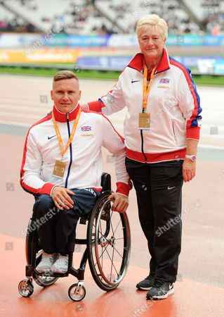 Stock Image of Paralympian David Weir with coach Jenny Archer, presenting her with an Unsung Hero award