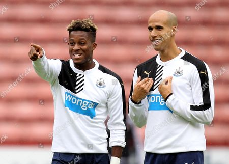 Newcastle United's Rolando Aarons and Newcastle United's Gabriel Obertan share a joke while warming up