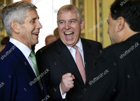 Prince Andrew speaks to guests including Sir Stuart Rose (left), as he hosts a tea for those responsible for assisting with the charity Key to Freedom at Buckingham Palace, London.