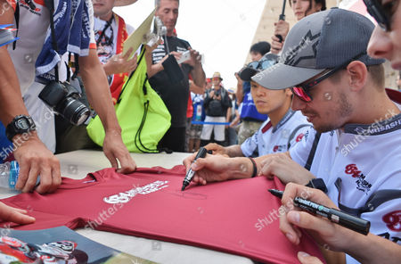 Stock Photo of Casey Stoner of Honda's MuSASHi RT signs autograph for Japanese fan