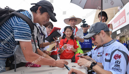 Casey Stoner of Honda's MuSASHi RT signs autograph for Japanese fan