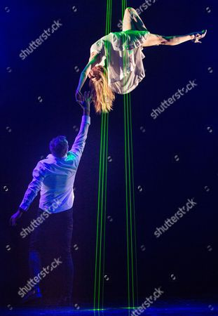 Stock Photo of Jamie Allan performs a levitation trick with Josephine Wormall at a photocall for 'Impossible' a new magic show opening at the Noel Coward theatre on July 30th