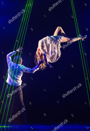 Stock Picture of Jamie Allan performs a levitation trick with Josephine Wormall at a photocall for 'Impossible' a new magic show opening at the Noel Coward theatre on July 30th