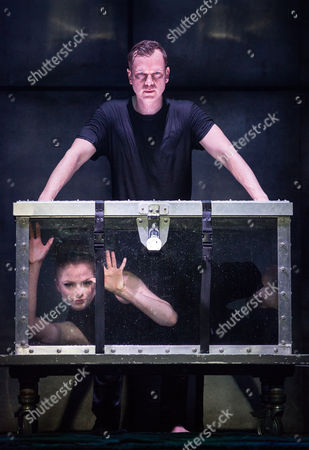 Josephine Wormall is pictured locked in a tank filled with water for a trick with Ali Cook at a photocall for 'Impossible' a new magic show opening at the Noel Coward theatre on July 30th