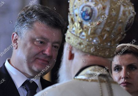 President of Ukraine Petro Poroshenko, left, and his wife Maryna Poroshenko, right, talking with the head of the Ukrainian Orthodox Church Patriarch Filaret, center, during the service, the day of celebration of the 1000th anniversary of the great Prince Vladimir