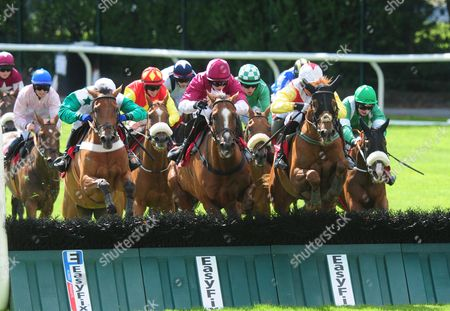 Galway POWERSBOMB & Mikey Fogarty (yellow sleeves) jump the last to win the Tote Jackpot Guarantee Handicap Hurdle from COLDSTONESOBER (Maroon) & BUSTER DAN DAN (Green & white)