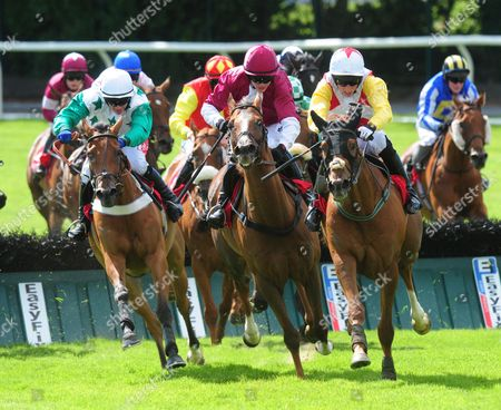 Stock Picture of Galway POWERSBOMB & Mikey Fogarty (yellow sleeves) jump the last to win the Tote Jackpot Guarantee Handicap Hurdle from COLDSTONESOBER (Maroon) & BUSTER DAN DAN (Green & white)