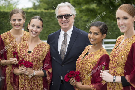 Alan Rickman gets a warm welcome from the flower girls