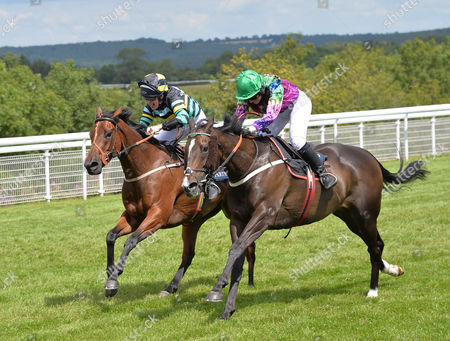 (R) Camilla Henderson and High Fidelity win The Magnolia Cup Goodwood Ladies' Race from (L) Dido Harding riding Armell on Ladies' Day At The Goodwood Festival @ Goodwood Racecourse. Pic: Hugh Routledge. 30.7.15