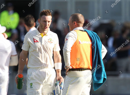 Stock Picture of Peter Nevill (left) of Australia is given a drink whilst batting by the man he replaced as wicketkeeper Brad Haddin.