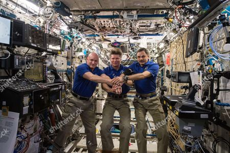 Aboard the International Space Station, Expedition 44 crew members Scott Kelly of NASA (left), Expedition Commander and Russian cosmonaut Gennady Padalka (middle), and Russian cosmonaut Mikhail Kornienko (right) commemorated the 40th anniversary of the joint Apollo-Soyuz mission