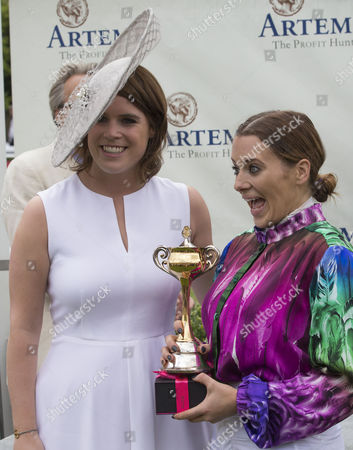 Camilla Henderson who won the Magnolia Cup in the Charity ladies race receives the cup from Princess Eugenie.